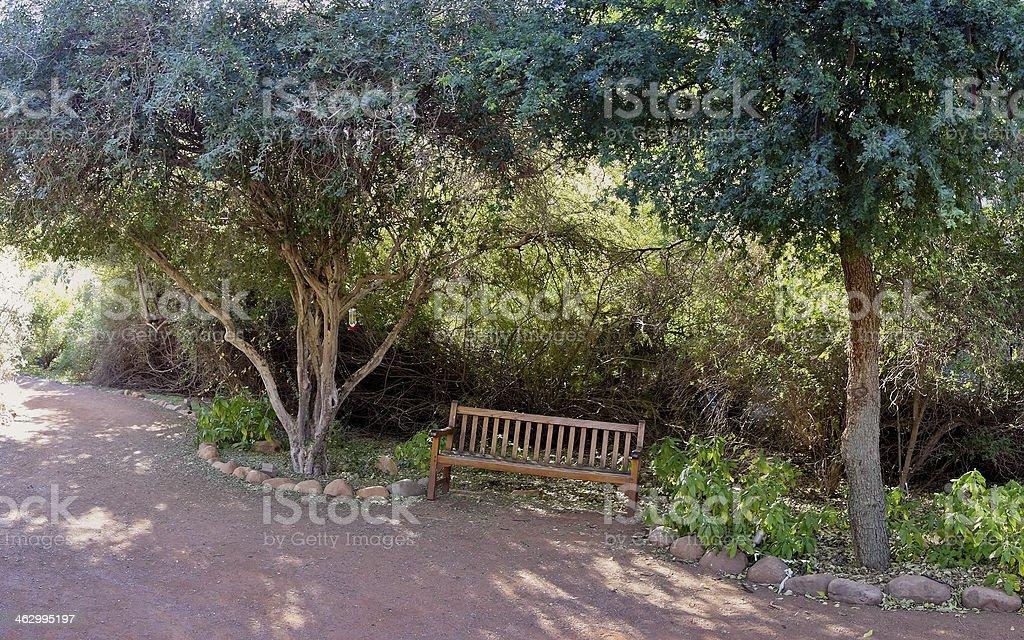 Welcoming Garden Bench stock photo