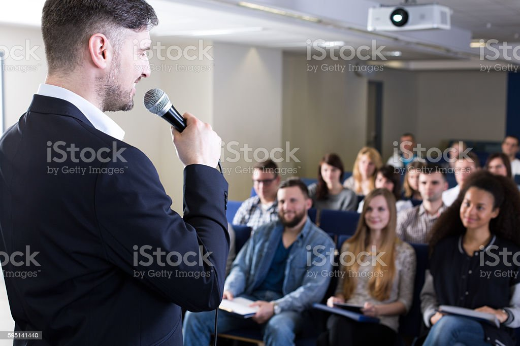 Welcoming his students in a new academic year stock photo