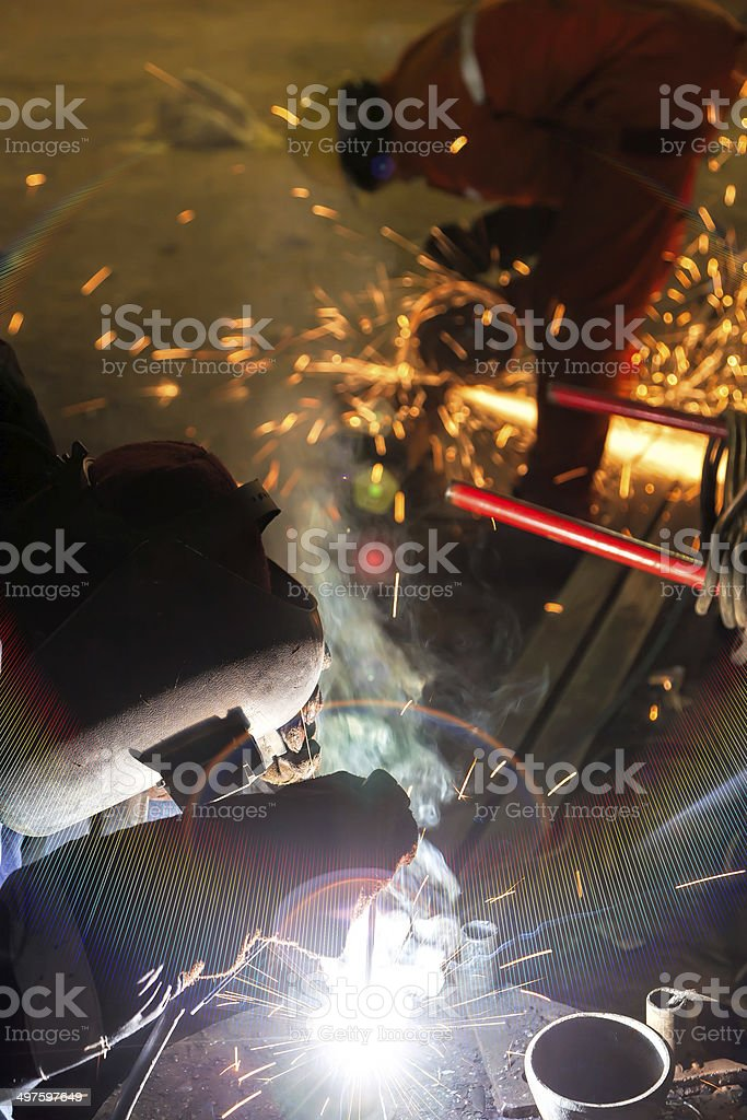 welder and worker are very busy stock photo