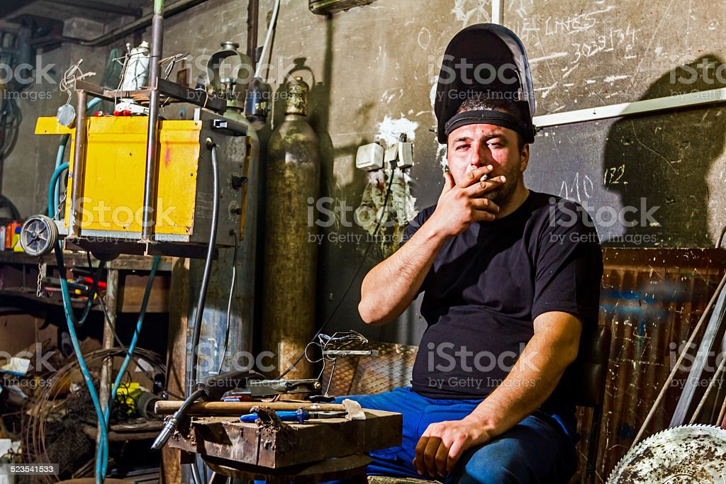 Welder at break stock photo