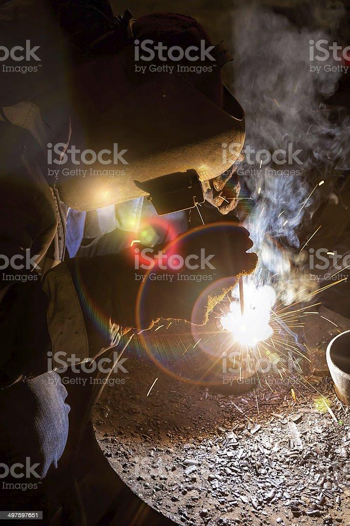 Welder at darkness stock photo