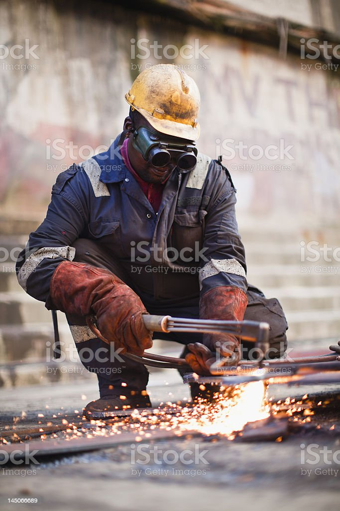Welder at work on dry dock stock photo