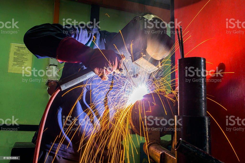 welder at workshop stock photo