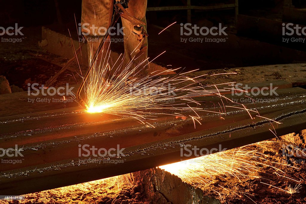 Welder cutting steel sheet with gas blow torch royalty-free stock photo