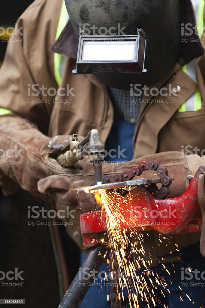 Welder cutting with torch stock photo
