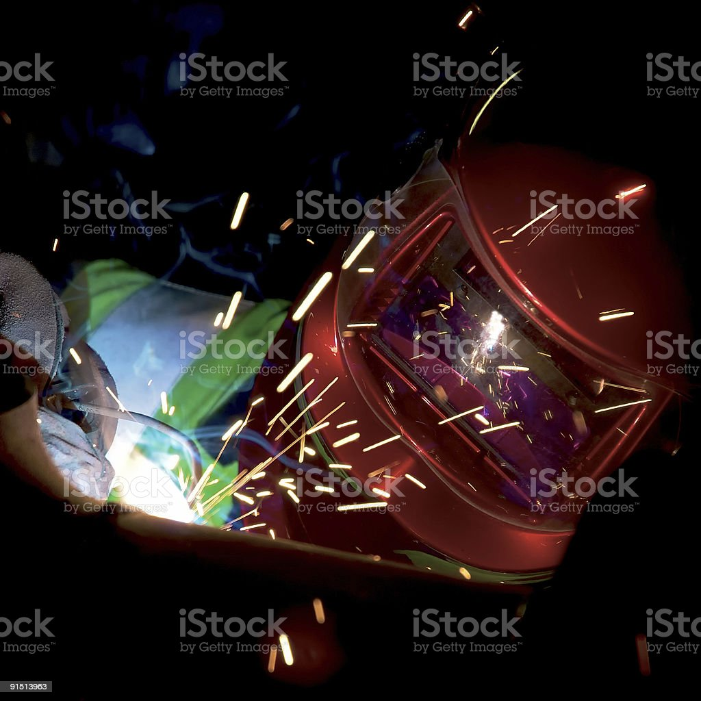 Welder Fabricating A Heating Pipe royalty-free stock photo