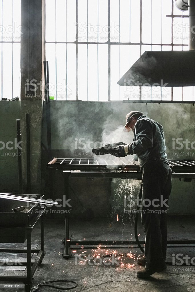 Welder in a factory. stock photo