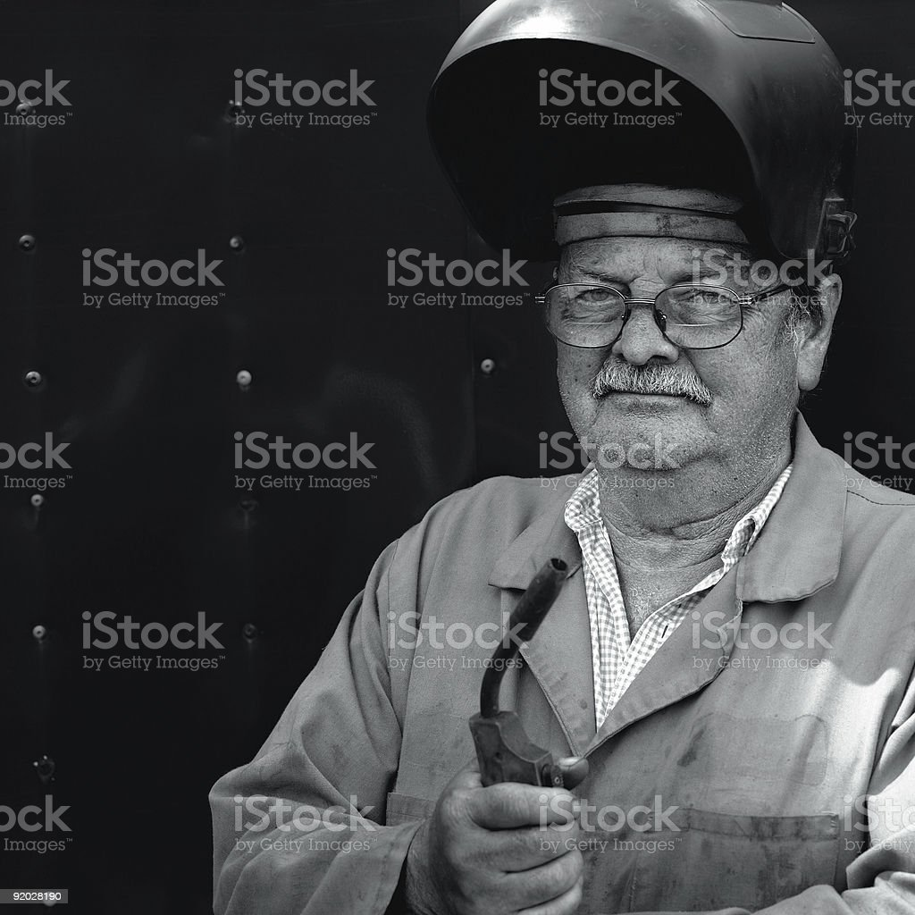 Welder in his 60's royalty-free stock photo
