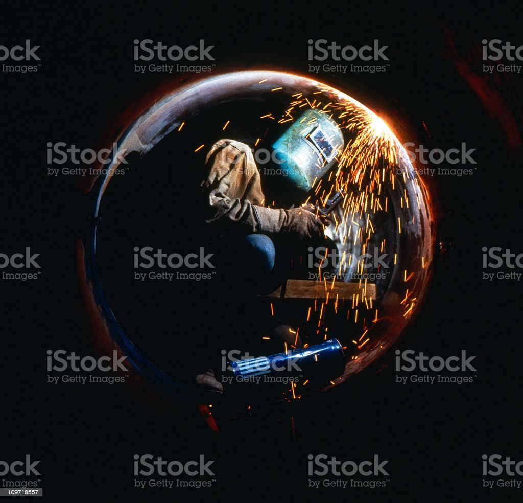 Welder in Pipe stock photo