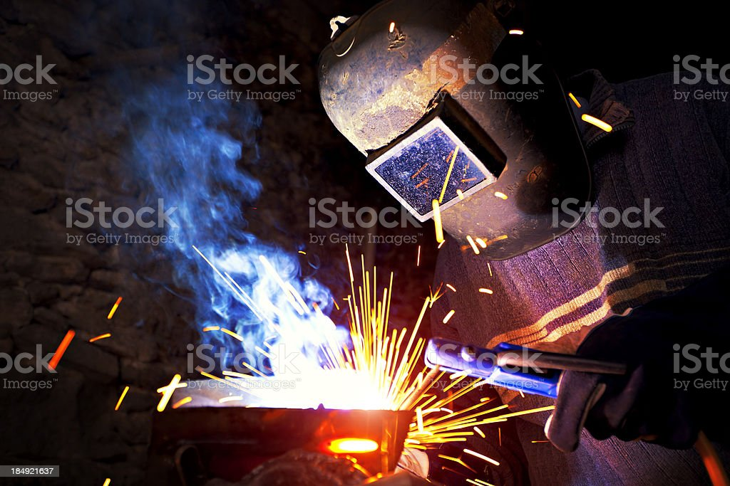 Welder in the mask while working. stock photo