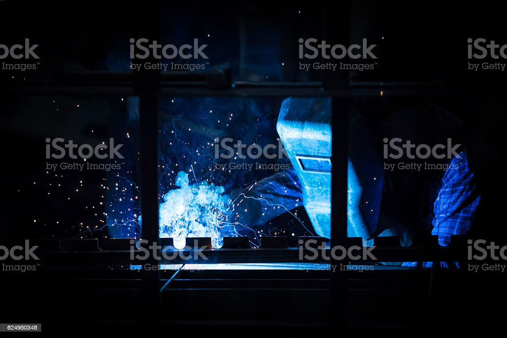 welder in the mask while working / welding stock photo