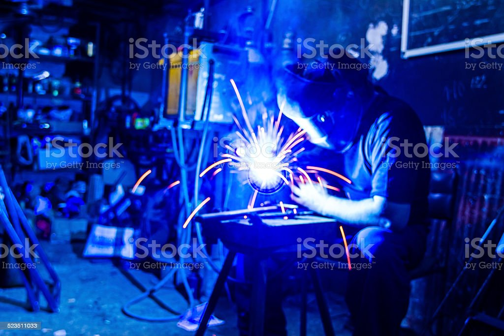 Welder in the workshop stock photo