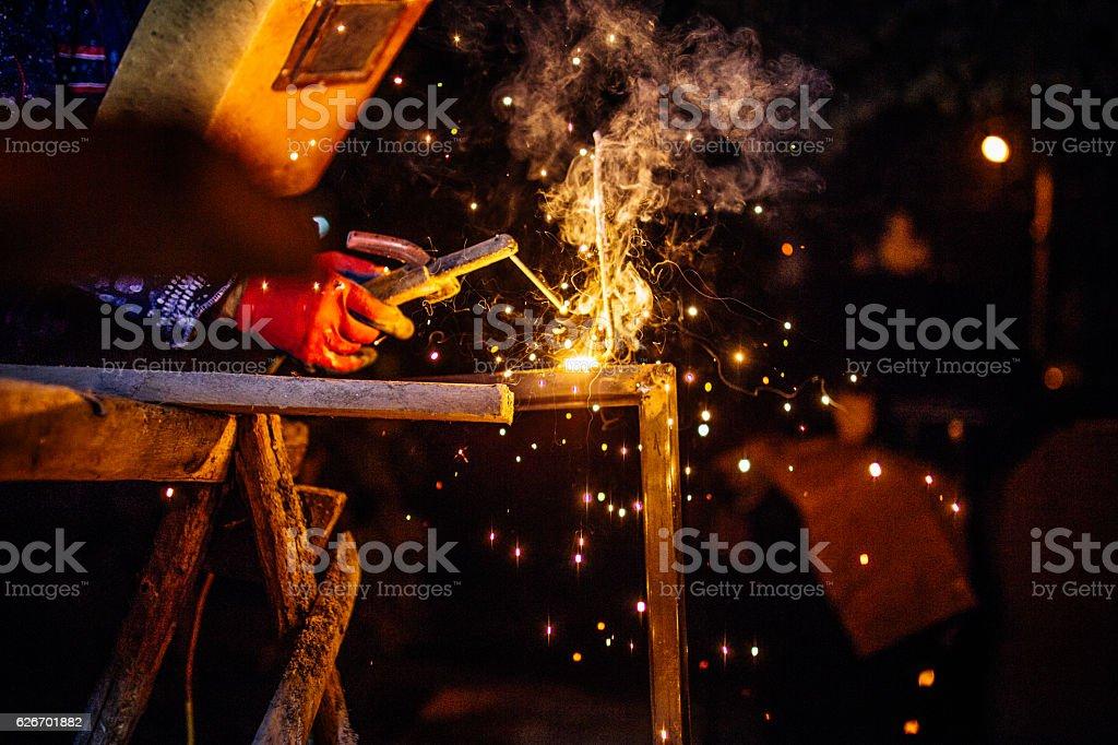 Welder lights stock photo