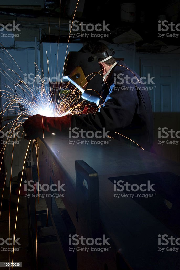 Welder making box section stock photo