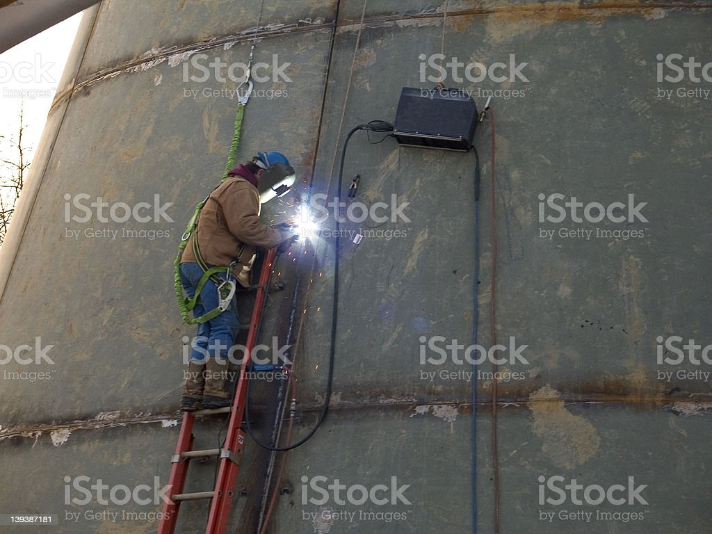 Welder on a Ladder. stock photo