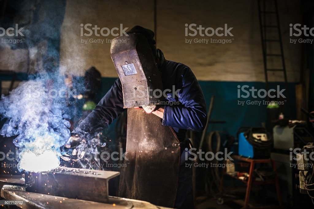 welder on a workshop stock photo