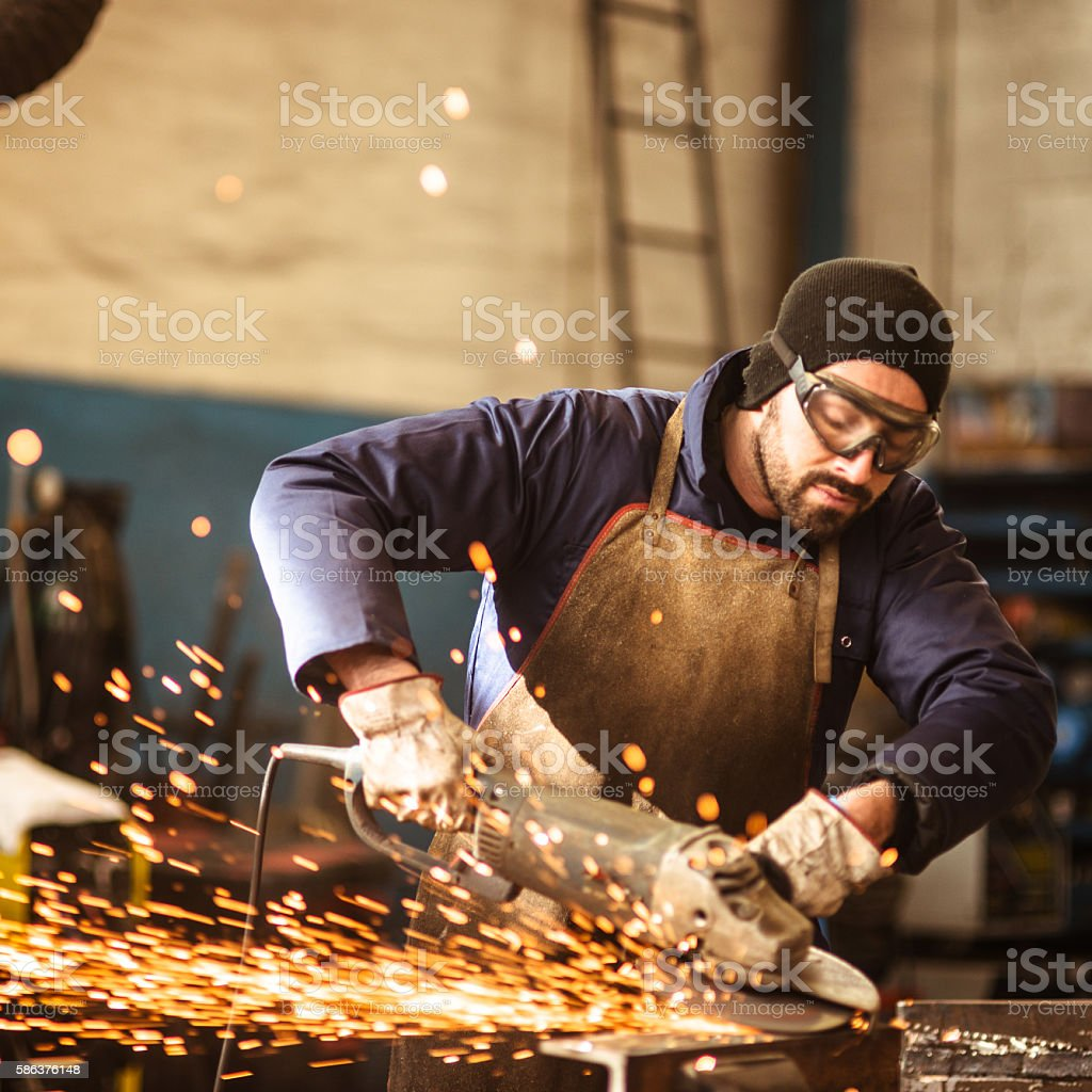 welder on a workshop stock photo