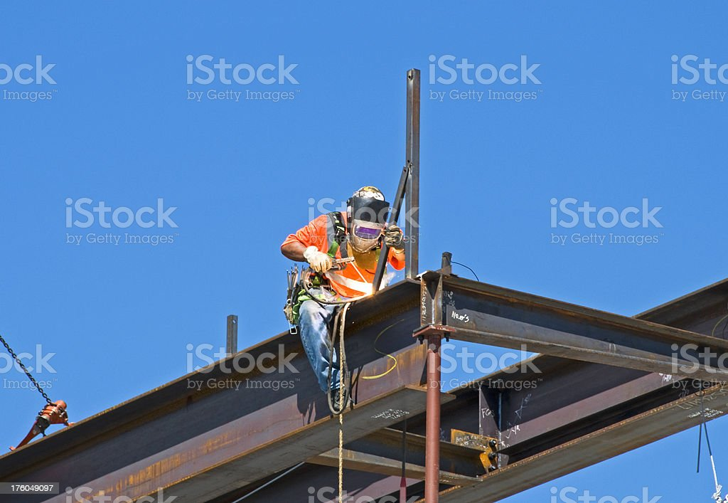 Welder on building under construction stock photo