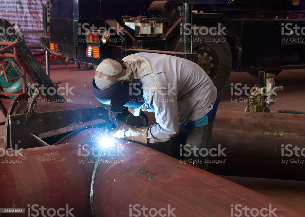 Welder on the pipe stock photo