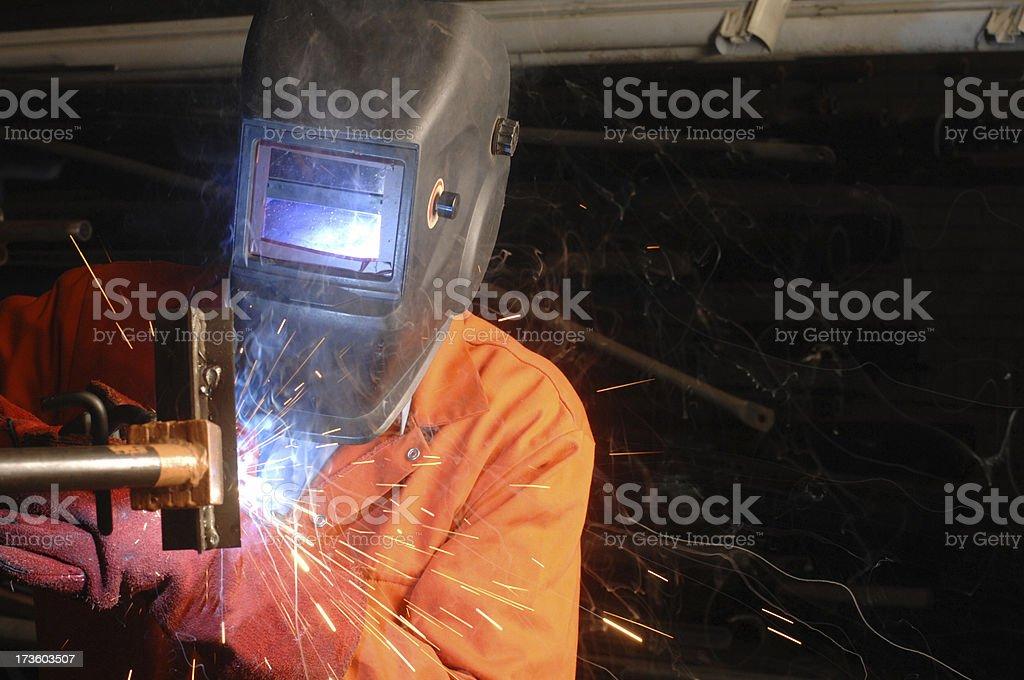 trainee welder sparking away