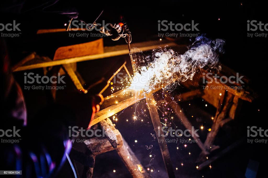 Welder welded metal rods
