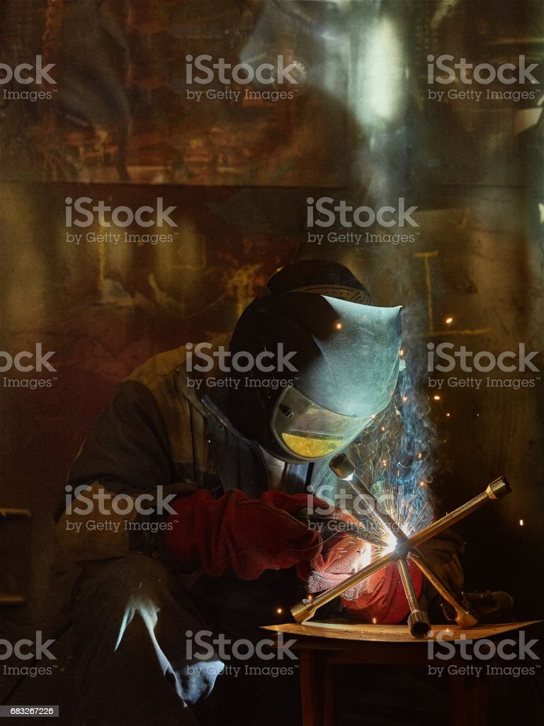 welder working with automatic welding