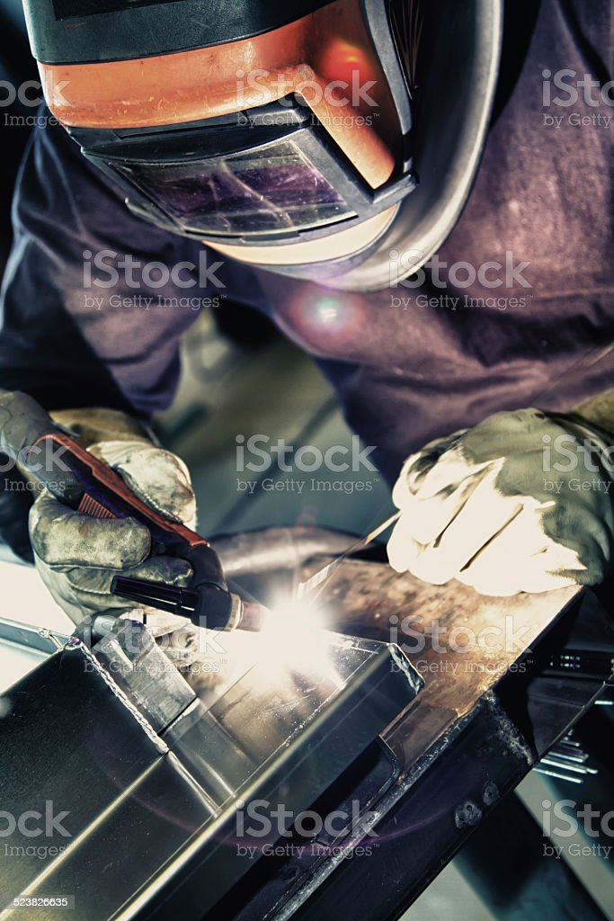 Welder to weld aluminum materials. stock photo