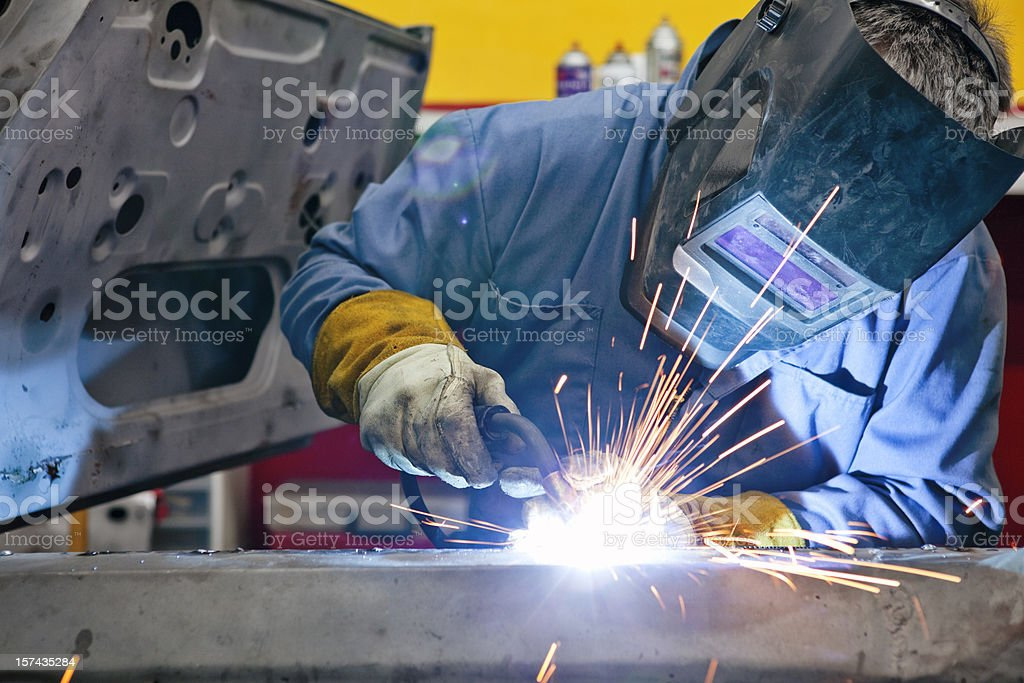 Welder Uses Torch on Car He is Welding stock photo