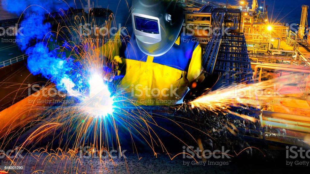 Welder welding at factory . stock photo