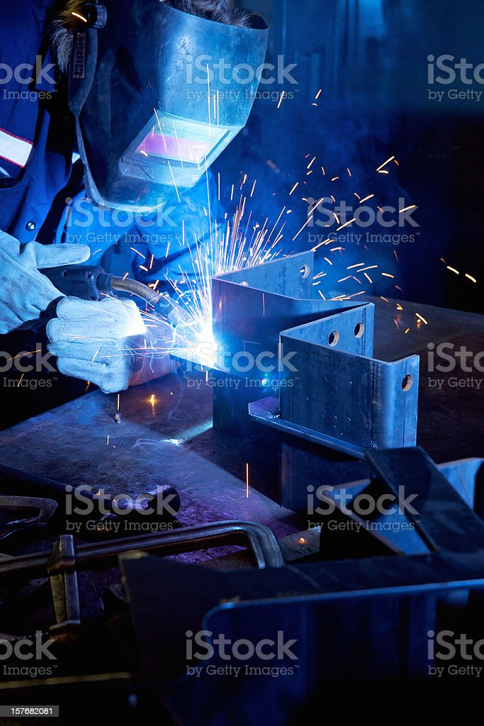 Welder welding in a manufacturing plant royalty-free stock photo
