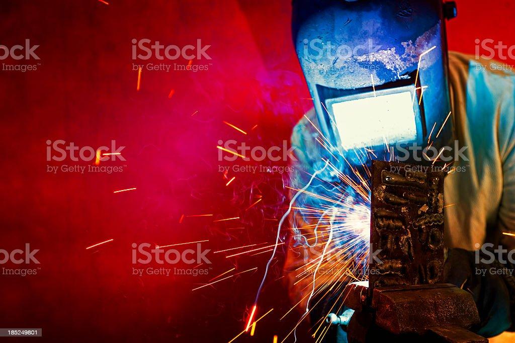 Welder welding, sparks fly. stock photo