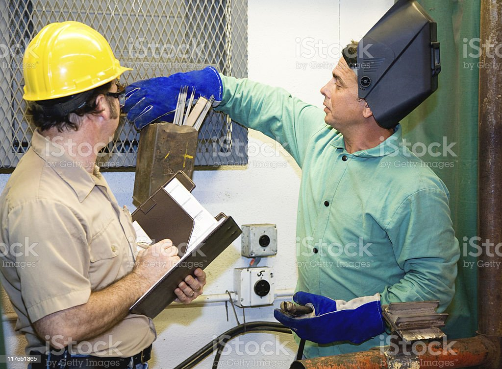 Welder with Supervisor stock photo