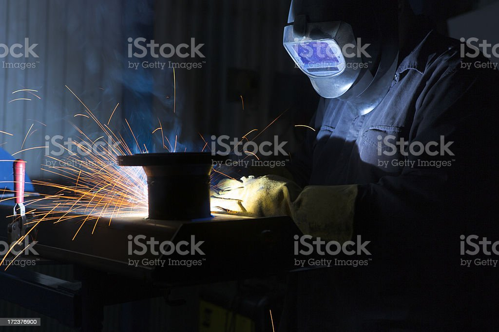 Welder with welding sparks royalty-free stock photo