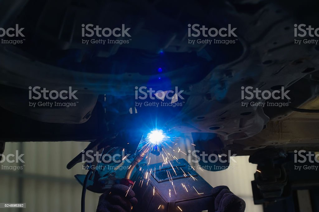 Welder working in protective mask stock photo