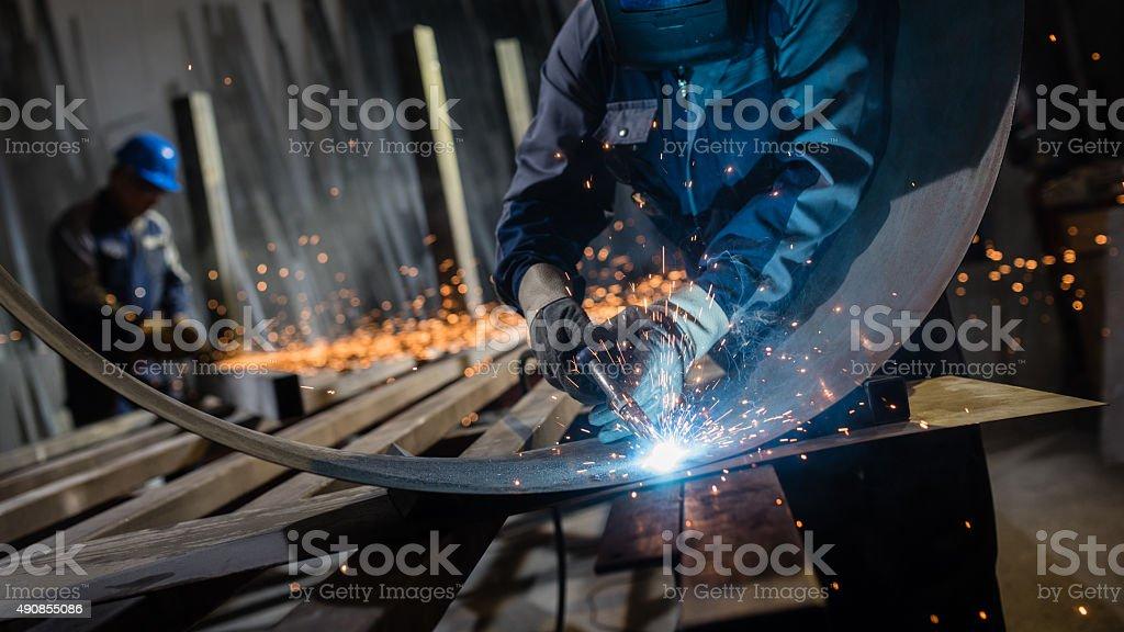 Welder working in workshop stock photo