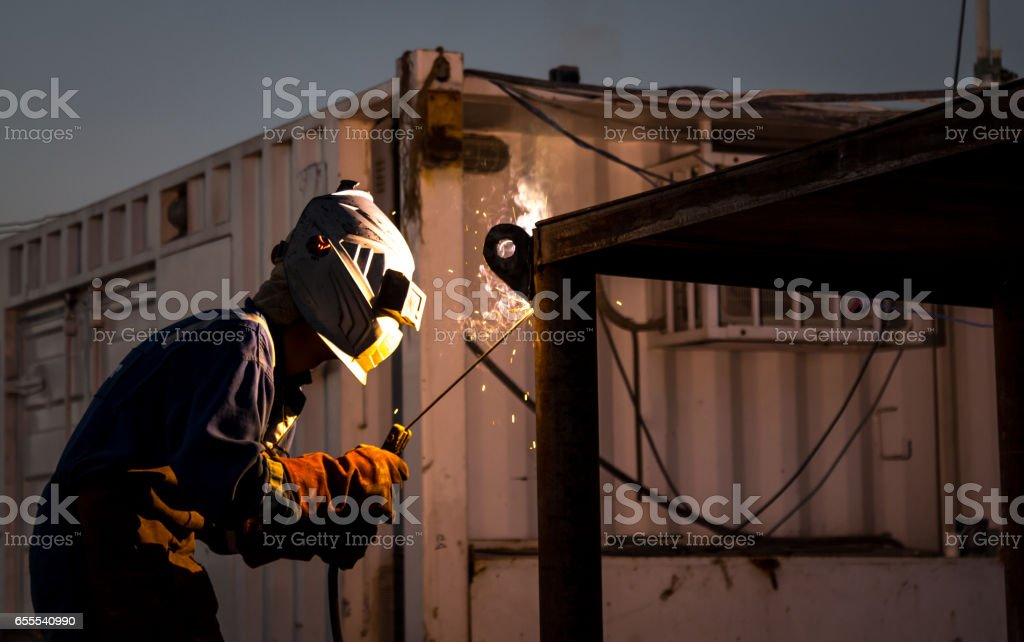 Welder working on the Oil Field stock photo
