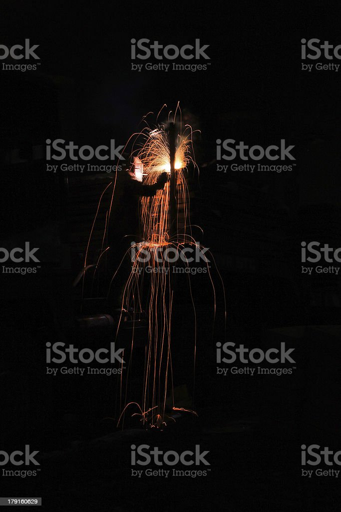 Welder works and creates sparkle stock photo