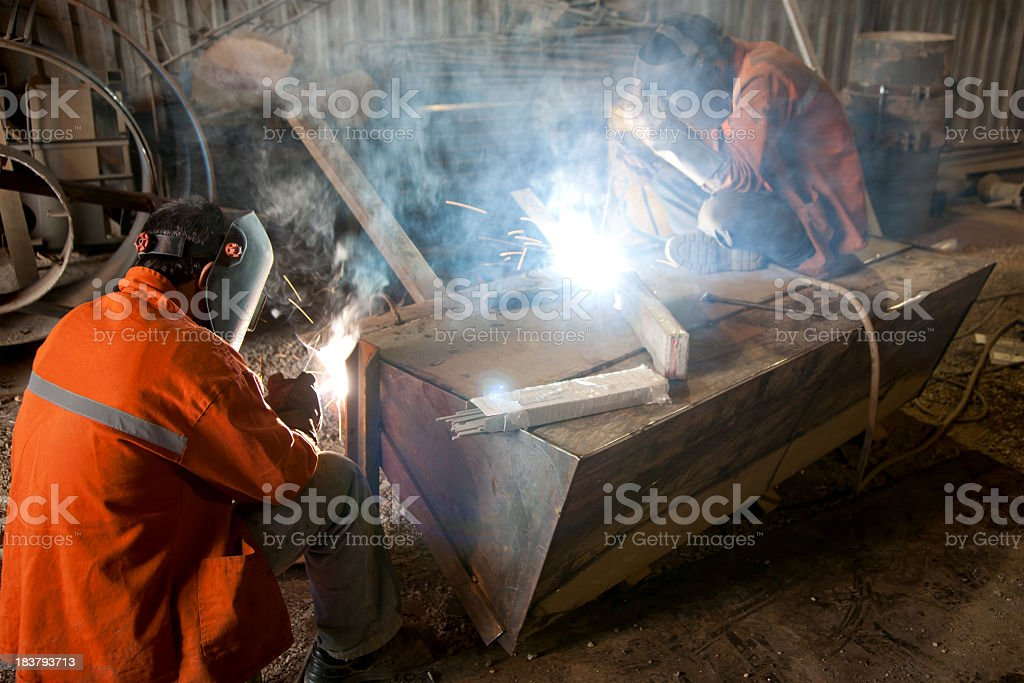welders are very busy royalty-free stock photo