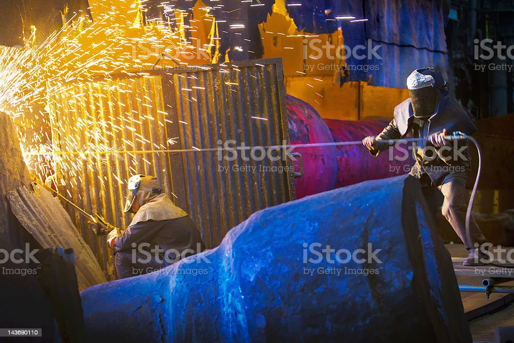 Welders at work in steel forge stock photo