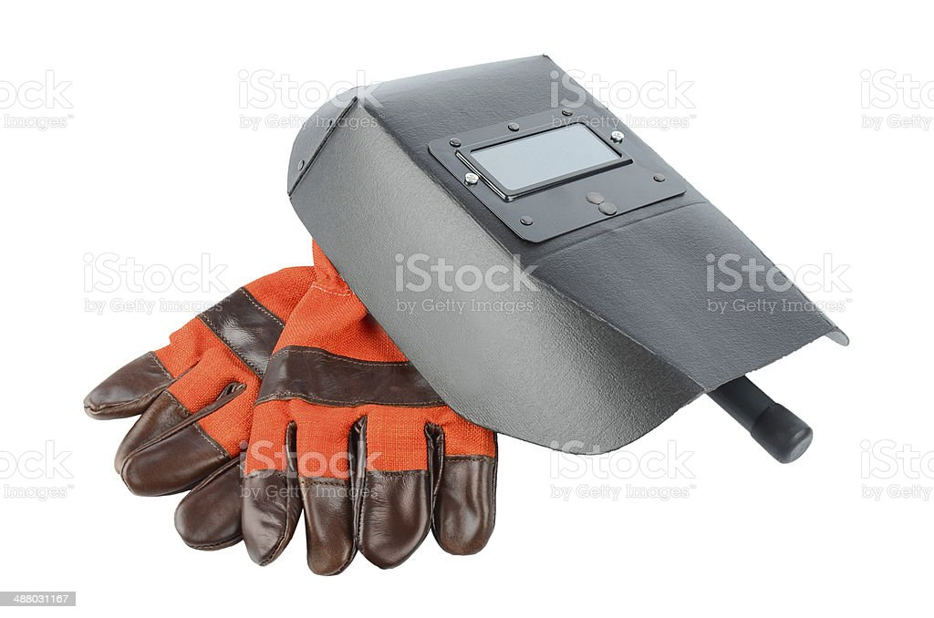 Welder's mask and gloves isolated on white background stock photo