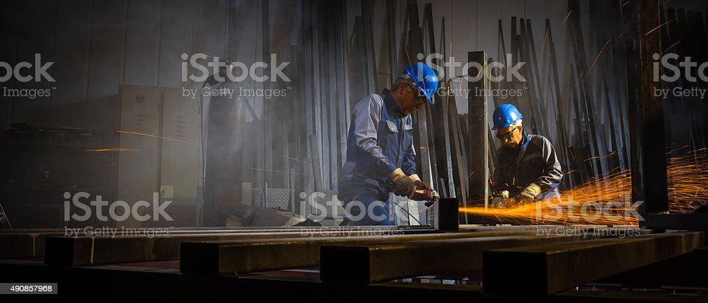Welders working in workshop stock photo