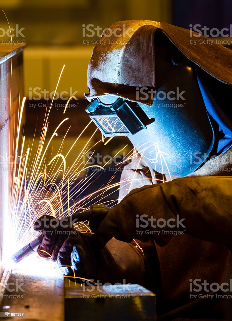 Welding and bright sparks stock photo