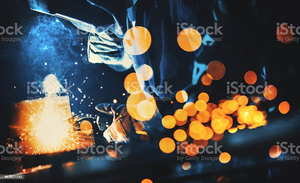 Welding at a workshop. stock photo