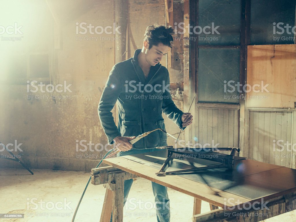 Welding device hanging in workplace stock photo