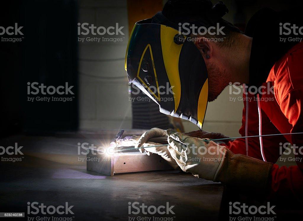 Welding engineer using TIG welder in steel fabrication factory stock photo