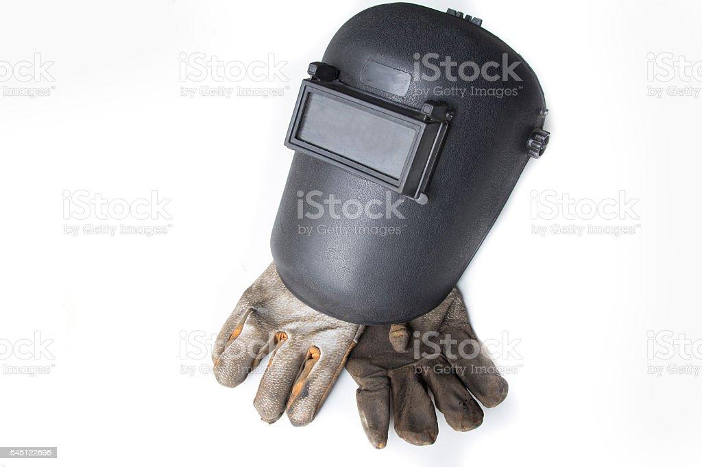 welding helmet and gloves stock photo
