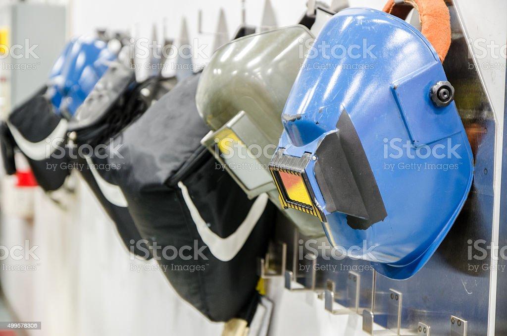Welding helmets on a board stock photo