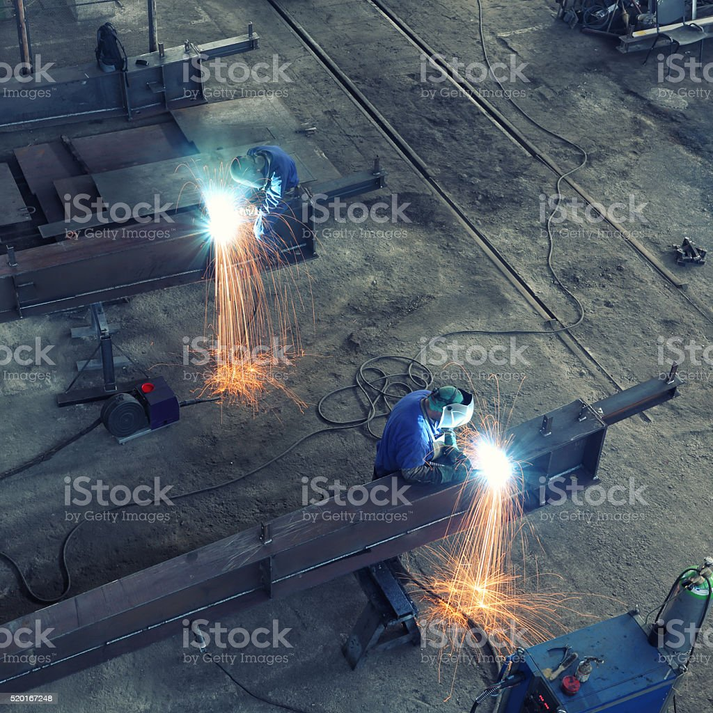 Welding huge steel beam stock photo