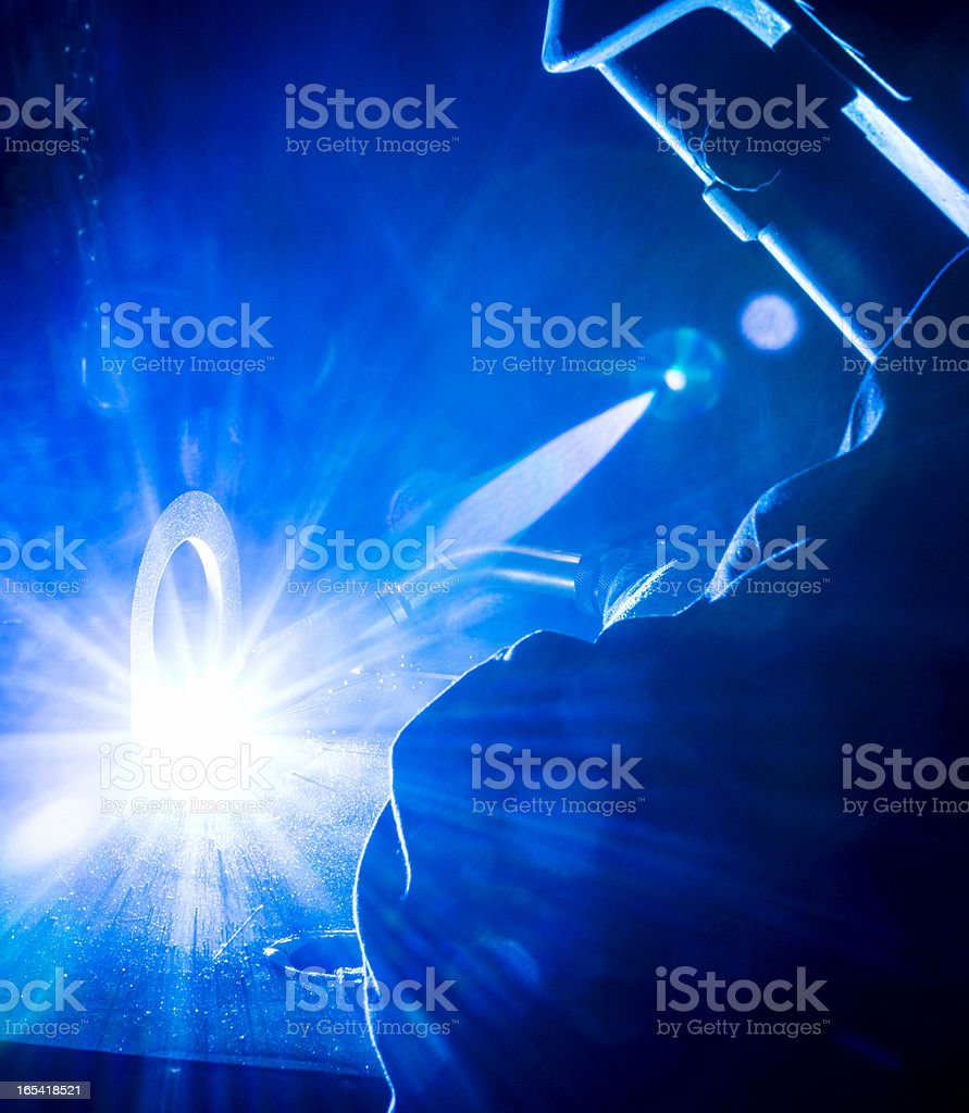 Welding in a metal manufacturing plant royalty-free stock photo