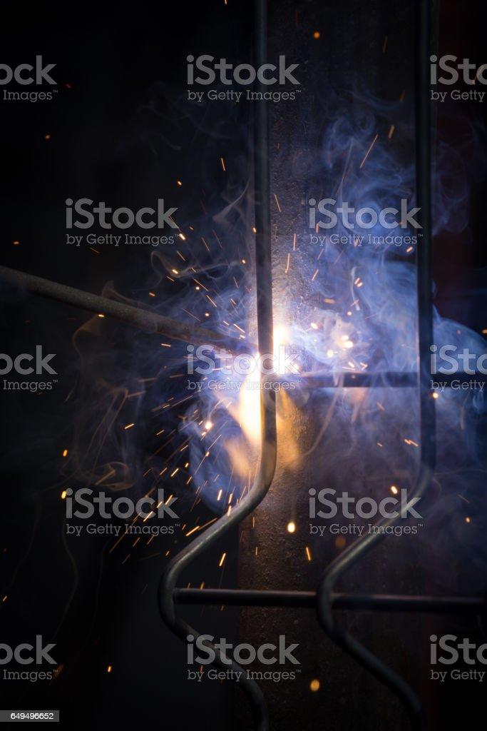 Welding metal parts macro shot stock photo
